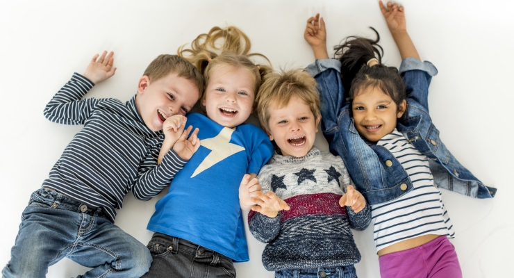 Four healthy, happy preschoolers laughing