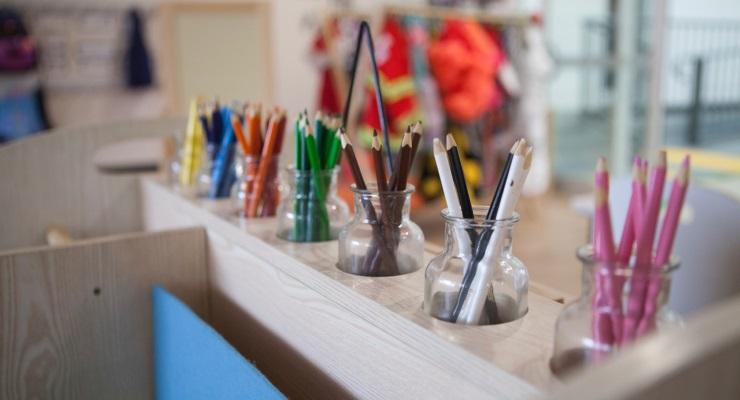 Rows of colouring pencils at a preschool