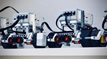 Two white & grey Lego robotics vehicles