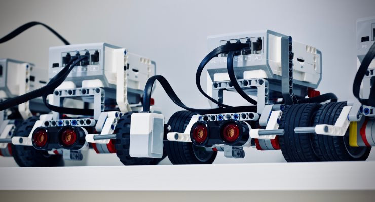 Two white & grey Lego robotics vehicles