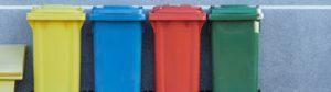Four coloured bins in a row